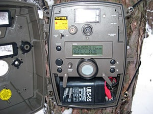 Inside moultrie game camera, shows battery
